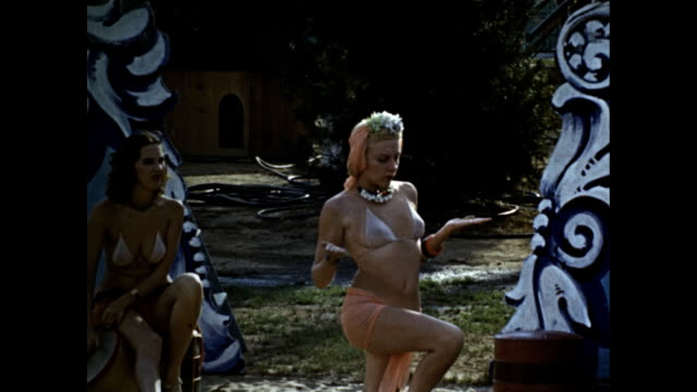 world's fair ntg congress of beauty and sun worshipers colony title card 'they like jacks' woman in sheer bikini playing jacks and smiling sitting on... - bikini stock-videos und b-roll-filmmaterial