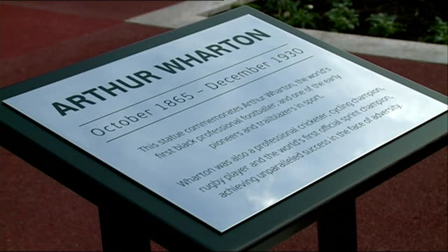 world's first black professional footballer arthur wharton honoured with statue / equality in football england staffordshire burtonontrent st... - erezione video stock e b–roll