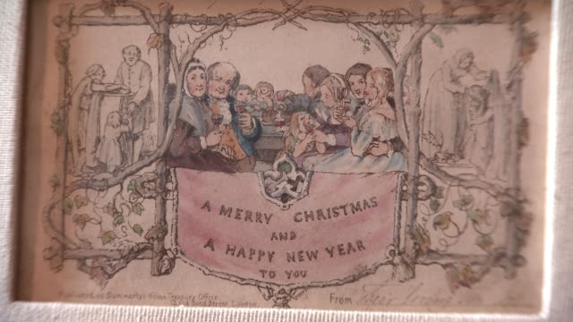 world's first christmas card on display at charles dickens museum england london charles dickens museum int first christmas card in frame leaning... - charles dickens stock videos and b-roll footage