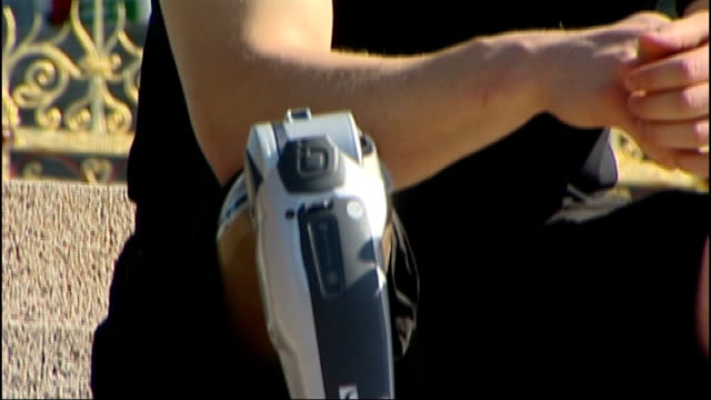 World's first motorised prosthetic knee ENGLAND London EXT David Jonsson along with reporter Close shots of prosthetic leg worn by David Jonsson as...
