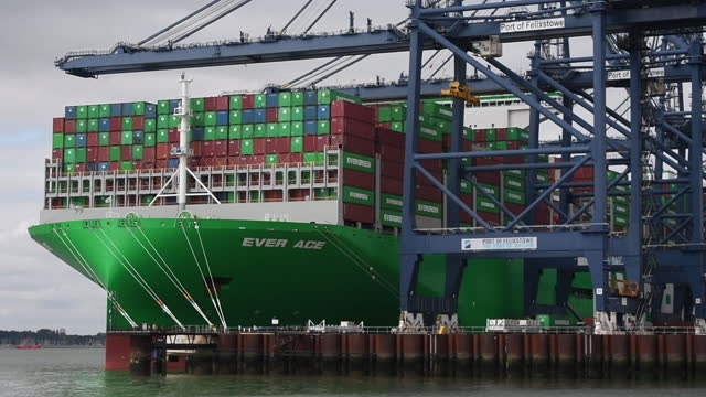 world's largest container ship, ever ace being loaded at port of felixtowe, in felixstowe, suffolk, england, u.k., on wednesday, september 15, 2021.... - western script stock videos & royalty-free footage