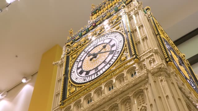 world's largest lego store opens in leicester square; england: london: leicester square: int historical lego logos and various of 'lester', the store... - tower stock videos & royalty-free footage