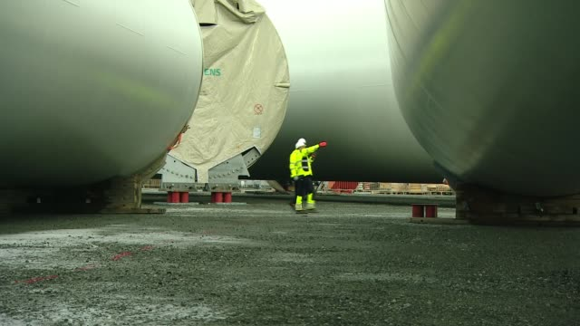 world's largest offshore wind farm generates electricity for the first time england east yorkshire hornsea ext duncan clark and reporter chatting as... - wind turbine stock videos & royalty-free footage