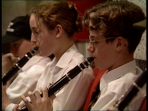 world's largest orchestra bid itn birmingham symphony hall violin being played by schoolgirl pull out to line of violinists playing lagv choir... - string instrument stock videos and b-roll footage