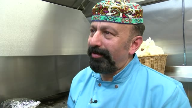 world's most expensive kebab england london int various shots onder sahan preparing royal kebabs in kitchen onder sahan interview sot cutaway... - offbeat stock videos and b-roll footage