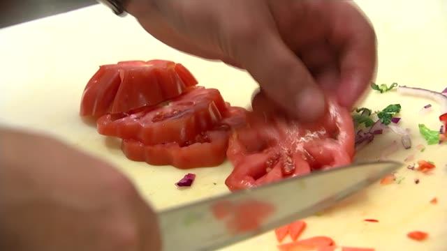 world's most expensive kebab prepared in restaurant; england: london: int various shots onder sahan preparing royal kebabs in kitchen - salad... - expense stock videos & royalty-free footage