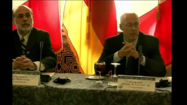worldwide economic crisis and credit crunch imf warning washington group of seen finance ministers meeting paulson shaking hands with british... - g7サミット点の映像素材/bロール