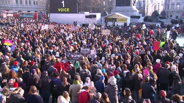 Worldwide Women's March protests against Donald Trump ENGLAND London Trafalgar Square Protesters with placards 'No to Trump No to war' PULL OUT crowd...