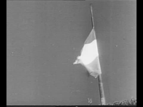 worm'seye italian flag is raised in trieste / montage italians watching applaud / ls down street of zone a the part of trieste which italy will... - italian flag stock videos and b-roll footage