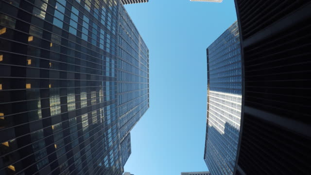 worm's-eye view of skyscraper buildings in metropolis. modern and urban city environment. - below stock videos and b-roll footage