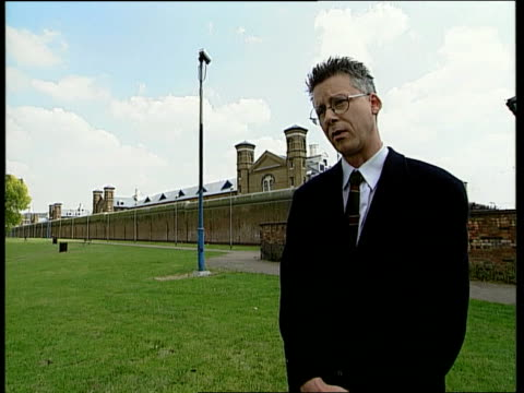 assault charges itn london nick flynn interview sot privatisation does not solve problems in prisons wormwood scrubs wall bird sitting on roof prison... - prison reform stock videos & royalty-free footage
