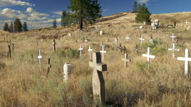 worn cemetery crosses on the colville indian reservation in eastern washington state - native american reservation stock videos & royalty-free footage
