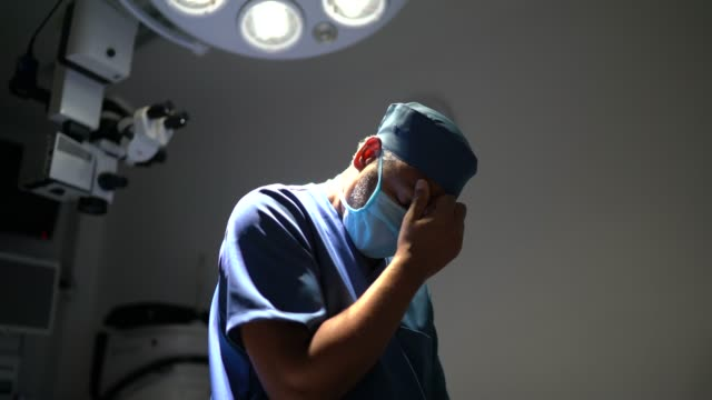 worried healthcare male nurse at operating room in hospital - mistake stock videos & royalty-free footage