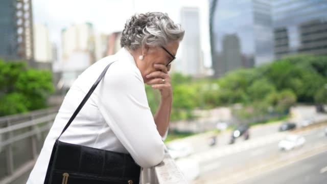 worried / hopelessness senior businesswoman at bridge - suicide stock videos & royalty-free footage