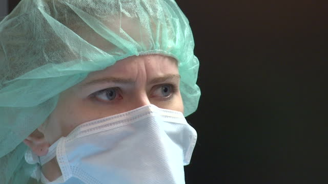 worried medical professional - surgical mask stock videos & royalty-free footage