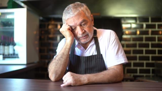 worried senior chef thinking - headache stock videos & royalty-free footage