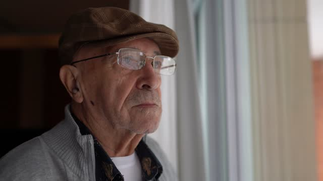 worried senior man contemplating at home - fragility stock videos & royalty-free footage