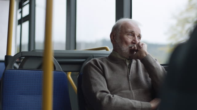 worried senior man riding on a bus - cable car stock videos & royalty-free footage