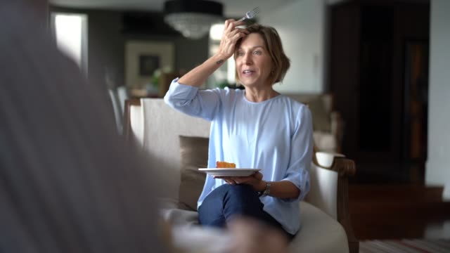 worried senior woman talking during family coffee break - image focus technique stock videos & royalty-free footage