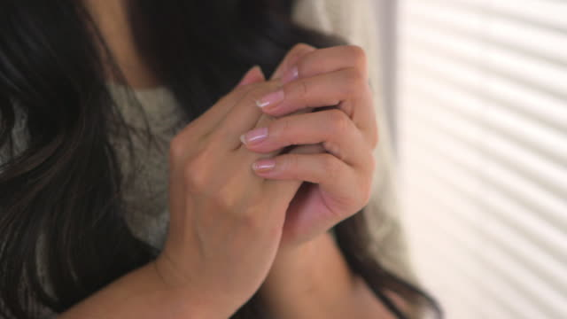 worried woman holding her hands - anxiety stock videos & royalty-free footage