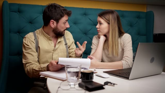 worried young couple arguing over finances at home - worried stock videos & royalty-free footage