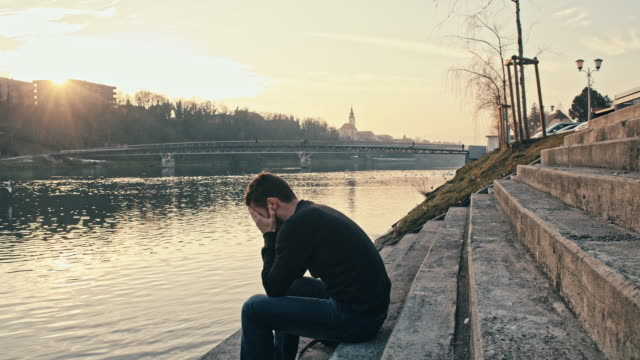 WS Worried Young Man By The River