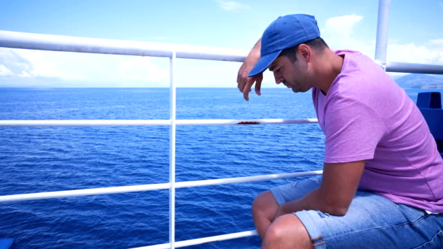 Worried young man on the boat deck