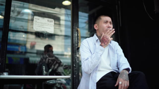 worried young man while smoking cigarette - millennial generation stock videos & royalty-free footage