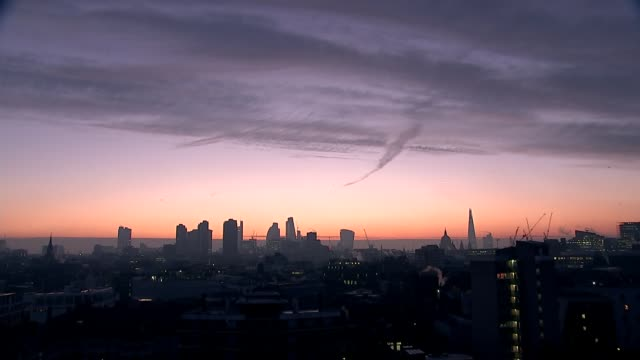 Worries over air quality trigger pollution alerts across the country ENGLAND London EXT London cityscape at dawn St Paul's Cathedral dome and The...