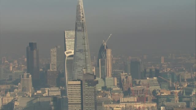 worries over air quality trigger pollution alerts across the country city skyscrapers including the shard and 'walkie talkie' - trigger stock videos & royalty-free footage
