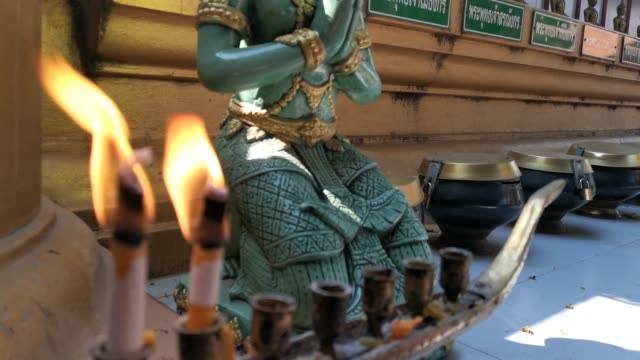Worship Buddha meditation incense and candles burning.