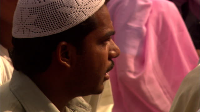 a worshiper wears a kufi and plays a drum. - kufi stock videos & royalty-free footage