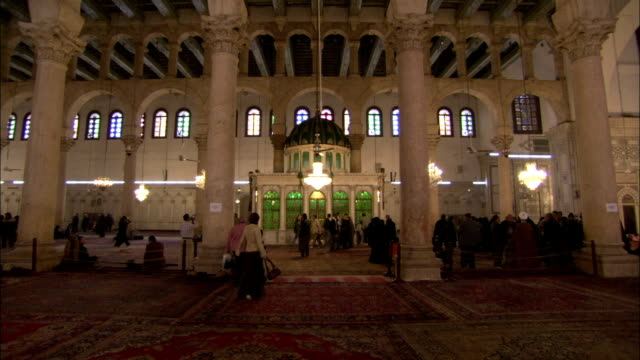Worshipers approach the shrine believed to hold the head of John the Baptist in the Umayyad Mosque Damascus. Available in HD.