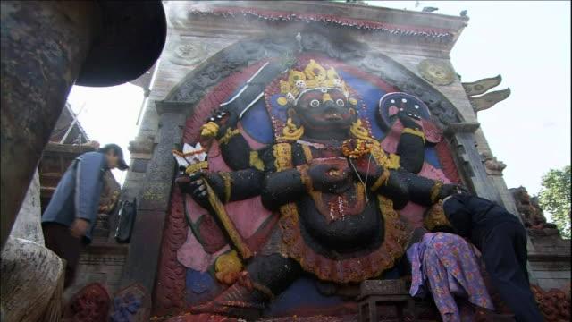 Worshipers at Shiva-Parvati temple Medium Shot