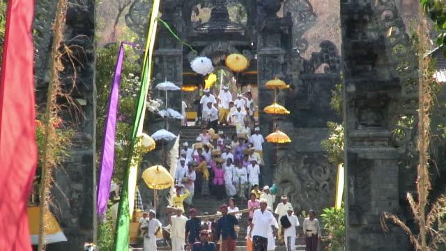 ZO, WS, HA, Worshipers descending steps in temple, Ubud, Indonesia, Bali