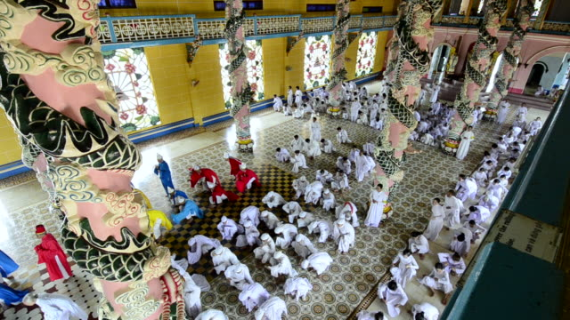 ms worshipers finishing midday prayer in cao dai temple / tay ninh, tay ninh province, viet nam - tay ninh stock videos & royalty-free footage