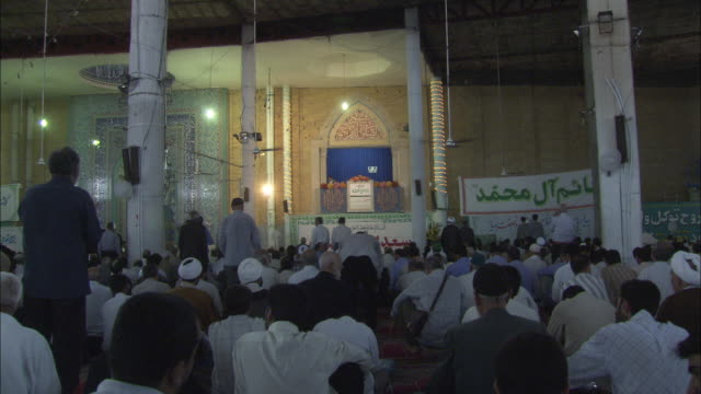 worshipers gather for friday prayer at the mosalla mosque in qom, iran. - mosque stock videos & royalty-free footage