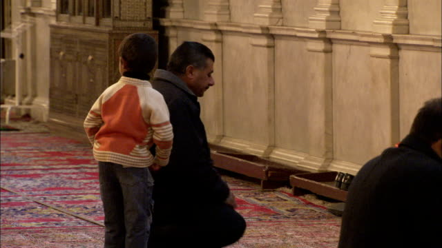 Worshipers kneel and pray at the Umayyad Mosque in Damascus. Available in HD.
