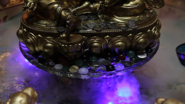 worshipers ladle water over a statue in the buddha tooth relic temple and museum in singapore. - ladle stock videos & royalty-free footage