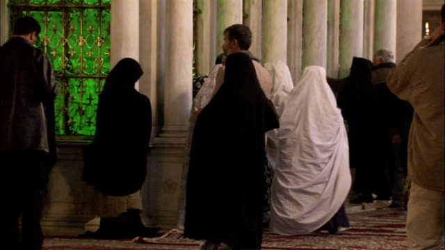 Worshipers pass the shrine in the Umayyad Mosque where the head of John the Baptist is believed to rest. Available in HD.