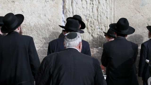 worshipers pray at the wailing wall in jerusalem, israel. - religion stock videos and b-roll footage