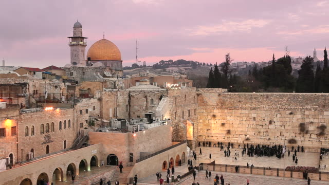 worshipers pray at the western wall in jerusalem. - twilight stock videos & royalty-free footage