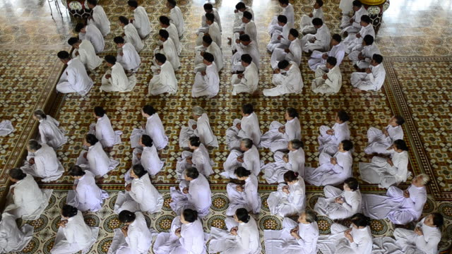worshipers prayer together in the cao dai temple in tay ninh, vietnam. - tay ninh stock videos & royalty-free footage