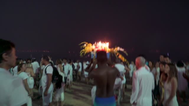 worshipers send handmade boat into the sea as year end offerings to iemanja the goddess of the sea of the afrobrazilian religion umbanda - 正月点の映像素材/bロール