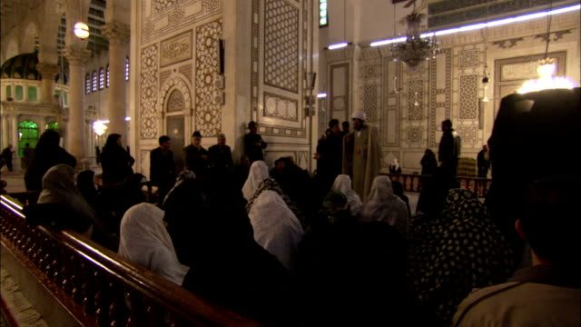 Worshipers sit in the Umayyad Mosque in Damascus. Available in HD.