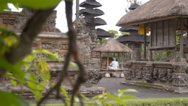 ws ds worshipper in hindu temple on bali - worshipper stock videos and b-roll footage