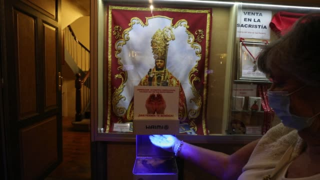 a worshipper uses a hydroalcoholic gel dispenser as she arrives to the 'misa de la escalera' at saint lorenzo church after the san fermin festival... - worshipper stock videos & royalty-free footage