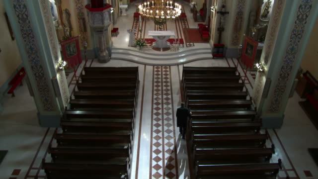 hd: worshipper walking down the aisle while leaving - worshipper stock videos and b-roll footage