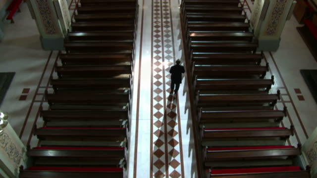 hd: worshipper walking down the church aisle - worshipper stock videos and b-roll footage