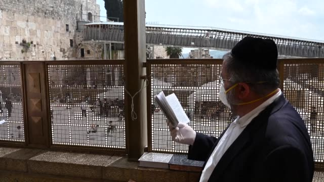 worshippers continue to pray near the western wall but amid coronavirus fears the streets of jerusalem's old city empty - human settlement stock videos & royalty-free footage